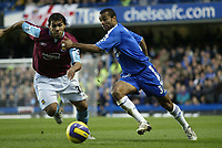 Photo: Marc Atkins.<br />Chelsea v West Ham United. The Barclays Premiership. 18/11/2006. Carlos Tevez (L) of West Ham in &  Ashley Cole (R) in action