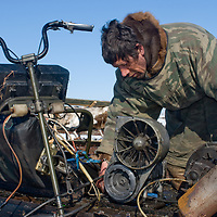 North of the Arctic Circle in Russia, Vasily Chuprov, a nomadic Komi reindeer herder,  repairs an aging Russian snowmobile the group uses for finding and herding their animals after nightly grazing in the wild.  Most men in the group have high mechanical skills after serving their mandatory two years in the military.  Ironically, the annual top prize for a regional reindeer-sled race is a snowmobile!