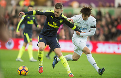SWANSEA, WALES - Saturday, January 14, 2017: <br /> Arsenal's Aaron Ramsey in action against Ki Sung-Yueng of Swansea City during the FA Premier League match at the Liberty Stadium. (Pic by Gwenno Davies/Propaganda)