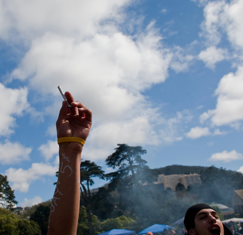 """""""420"""" also known as """"national smoke out day""""  is an unofficial holiday where people gather to celebrate and consume cannabis.  This annual events has become a social gathering and sometimes a family affair including a picnic, bbq, concerts, drum circle, and games.    Thousands of people are in attendance at 2010 """"420"""" celebration at Hippie Hill inside Golden Gate Park in San Francisco, California."""