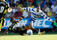 Photo: Steve Bond/Richard Lane Photography. Reading v Watford. Coca Cola Championship. 26/09/2009. Jobi McAnuff is tackled by Adrian Mariappa (L)