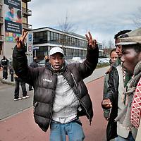 Nederland, Amsterdam , 16 april 2015.<br /> Illegalen in hun tijdelijk nieuwe onderkomen op de Jan Tooropstraat.<br /> Op de foto: Illegalen vertrekken vanuit de Jan Tooropstraat naar Den Haag om daar te gaan demonstreren.<br /> De eigenaar van het pand dat woensdag is gekraakt voor de uitgeprocedeerde asielzoekers in Amsterdam-West heeft hiervan donderdag aangifte gedaan. Dat liet een woordvoerder van de gemeente weten.<br /> Illegal immigrants in their temporary new home at  the Jan Tooropstraat in Amsterdam are on their way to The Hague to protest.