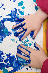 Child painting at adult education centre,