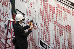 June 21, 2017 - Tokyo, Tokyo, Japan - A organizer of the fair applies a red sticker written Sold on the booth map booked for the next fair at Tokyo big site in Japan. (Credit Image: © Alessandro Di Ciommo via ZUMA Wire)