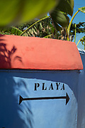 Close-up of information sign with arrow pointing to beach, Cadiz, Andalusia, Spain