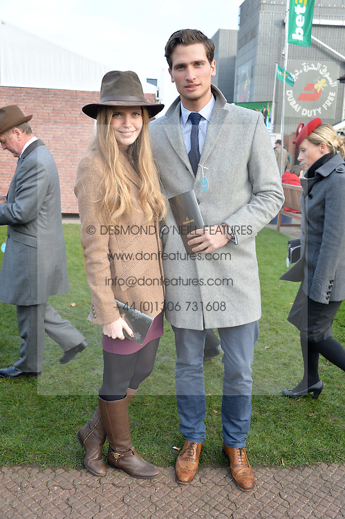 KATIE READMAN and TOM WARREN at the 2013 Hennessy Gold Cup at Newbury Racecourse, Berkshire on 30th November 2013.