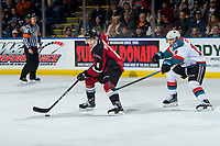 KELOWNA, BC - JANUARY 26: Ethan Ernst #19 of the Kelowna Rockets stick checks Dylan Plouffe #6 of the Vancouver Giants as he skates with the puck at Prospera Place on January 26, 2019 in Kelowna, Canada. (Photo by Marissa Baecker/Getty Images)