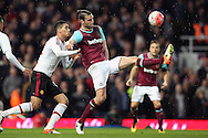 Andy Carroll of West Ham United in action. The Emirates FA cup, 6th round replay match, West Ham Utd v Manchester Utd at the Boleyn Ground, Upton Park  in London on Wednesday 13th April 2016.<br /> pic by John Patrick Fletcher, Andrew Orchard sports photography.
