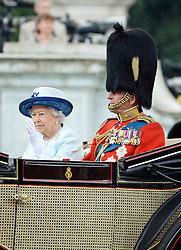 © Licensed to London News Pictures. 14/06/2014. London, UK Queen Elizabeth; Prince Philip Duke of Edinburgh, Trooping the Colour, Buckingham Palace, London UK, 14 June 2014. Photo credit : Mike Webster/PIQ/LNP