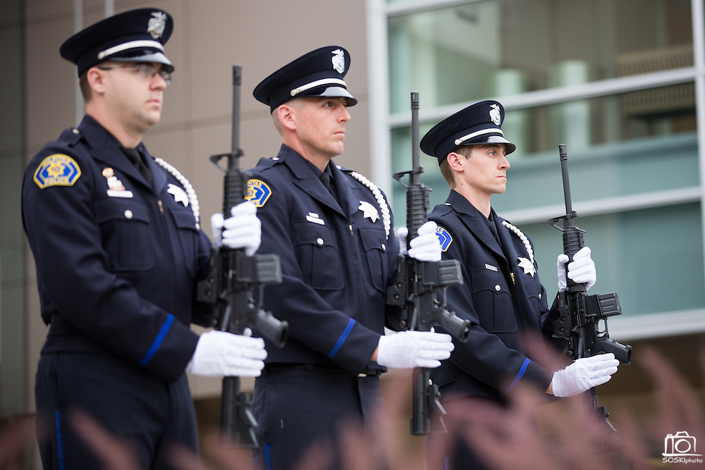 The Milpitas Police Department performs a 21-Gun Salute during the Milpitas Memorial Day Ceremony at Veterans Memorial Flag Plaza in Milpitas, California, on May 27, 2013. (Stan Olszewski/SOSKIphoto)