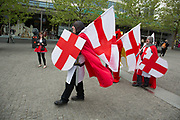 London, UK. Wednesday 23rd April 2014. Men dressed up as Saint George on St George's Day. With chainmail, St Georges Cross shields and flags, this type of dressing up has become popular as a sign of patriotism and fun as groups go out drinking on the 23rd April each year.