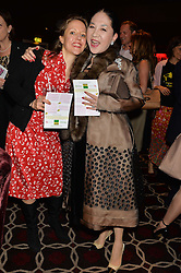 Left to right, EMILIA HUNGERFORD and the DOWAGER VISCOUNTESS ROTHERMERE at the Pig Pledge Evening at Club no41, 41 Conduit Street, London on 10th March 2014.