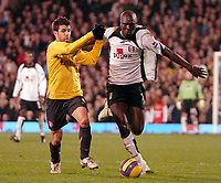 Photo: Ed Godden.<br /> Fulham v Arsenal. The Barclays Premiership. 29/11/2006.<br /> Fulham's Papa Bouba Diop (R) is held back by Cesc Fabregas.