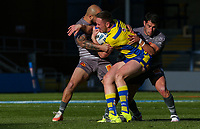 Warrington Wolves' Ben Currie is tackled by Catalans Dragons' Alrix Da Costa and Benjamin Garcia<br /> <br /> Photographer Alex Dodd/CameraSport<br /> <br /> Rugby League - Betfred Challenge Cup Quarter Finals - Catalans Dragons v Warrington Wolves - Friday 7th May 2021 - Emerald Headingley Stadium - Leeds<br /> <br /> World Copyright © 2021 CameraSport. All rights reserved. 43 Linden Ave. Countesthorpe. Leicester. England. LE8 5PG - Tel: +44 (0 116 277 4147 - admin@camerasport.com - www.camerasport.com