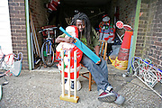 Yomi, 43, TV creative director in his garage in South East London. His lock up is stuffed with very strange things: old computers, camping gear, a plastic snowman, a reindeer, a plastic santa, a cricket gear, a St Andrew's cross...