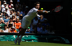 LONDON, July 2, 2018  Dusan Lajovic of Serbia hits a return during the men's singles first round match against Roger Federer of Switzerland at the Championship Wimbledon 2018 in London, Britain, on July 2, 2018. Dusan Lajovic lost 0-3. (Credit Image: © Shi Tang/Xinhua via ZUMA Wire)