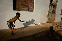 cuban boy playing alone in streets