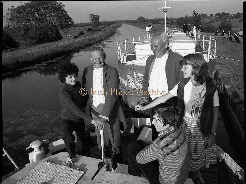 Robertstown Grand Canal Festival.  (N87)..1981..30.07.1981..07.30.1981..30th July 1981..A reception was held today to announce the launch of the Annual Grand Canal Festival at Robertstown, Co Kildare. The festival features a series of weekend family entertainments in August/September. This years event will be sponsored by Guinness Group Sales, Irl Ltd...Pictured taking a lesson in navigation from veteran boatmen John Conroy, Lowtown and Thomas Hannon, Robertstown were the Porter children, Geoffrey, Jennifer and James at the helm of one of the Robertstown barges which will ferry passengers on tours of the canal during the festival.