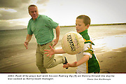 PAIDI IS DEFIANT ON STAYING AS KERRY MANAGER...Paidi O'Se plays ball with his son Padraig (9) on Ventry Strand on Saturday morning and defiantly stated he wanted to remain as Kerry Team Manager for another season. Paidi, who has served Kerry football for 30 years, feels he was badly treated by the Kerry County Board Chairman Sean Walsh.