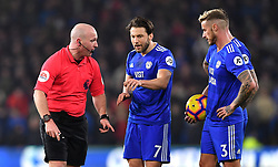 Referee Roger East (left) in discussion with Cardiff City's Harry Arter (cenre) during the Premier League match at the Cardiff City Stadium.