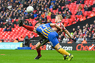 Elliot Whitehouse of Lincoln City (4) takes a shot at goal but is blocked by James Bolton of Shrewsbury Town (13) during the EFL Trophy Final match between Lincoln City and Shrewsbury Town at Wembley Stadium, London, England on 8 April 2018. Picture by Stephen Wright.