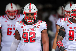 Sep 14, 2019; Morgantown, WV, USA; North Carolina State Wolfpack defensive tackle Larrell Murchison (92) walks onto the field before their game against the West Virginia Mountaineers at Mountaineer Field at Milan Puskar Stadium. Mandatory Credit: Ben Queen-USA TODAY Sports
