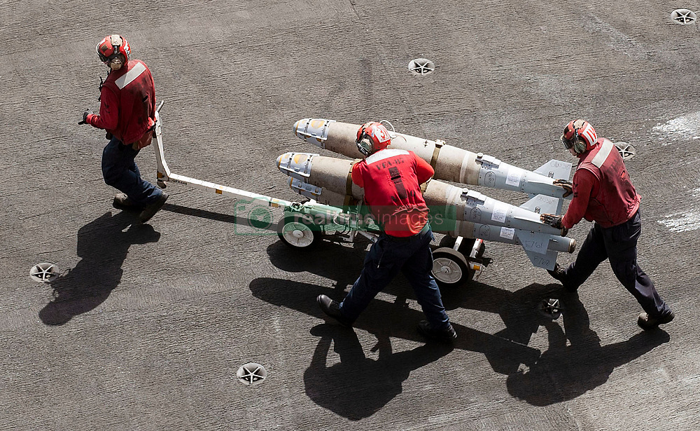 ARABIAN GULF (May 22, 2017) Sailors move ordnance on the flight deck of the aircraft carrier USS George H.W. Bush (CVN 77). The ship is deployed in the U.S. 5th Fleet area of operations in support of maritime security operations designed to reassure allies and partners, and preserve the freedom of navigation and the free flow of commerce in the region. (U.S. Navy photo by Mass Communication Specialist 3rd Class Mario Coto/Released)170522-N-JC445-081 <br /> Join the conversation:<br /> http://www.navy.mil/viewGallery.asp<br /> http://www.facebook.com/USNavy<br /> http://www.twitter.com/USNavy<br /> http://navylive.dodlive.mil<br /> http://pinterest.com<br /> https://plus.google.com