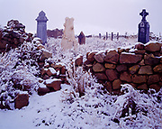 Snow gracing overgrown cemetery at Galisteo, New Mexico.