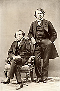 Johannes Brahms (1833-1897) German composer, seated, with  Joseph Joachim (1831-1907) Hungarian violinist and composer and director of the Berlin Conservatory.   Halftone from a photograph.