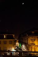 A night scene of a Lisbon street from a balcony.