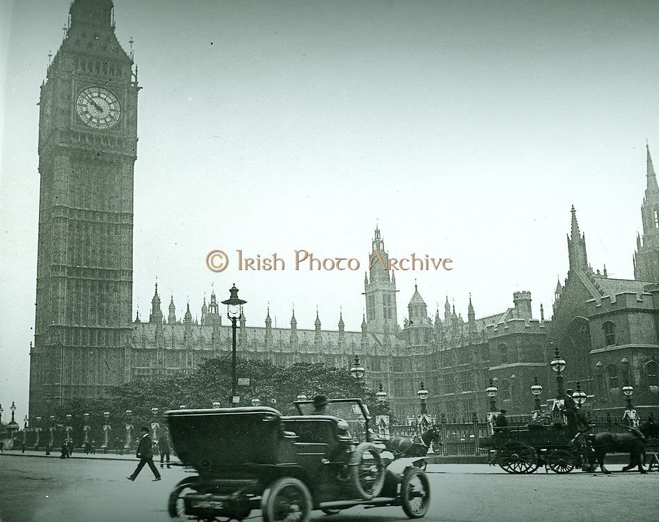 Parliament Square, London, c1906, showing early electric lamps, an automobile (car) and a horse drawn carriage or cart.