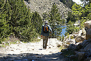 Aigüestortes i Estany de Sant Maurici National Park, Catalonia, Spain Hiker in the park. Model release available