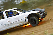 Car 77 catches fire as it races around the track during the race meeting at Smallfield Raceway, Surrey, UK on the 10th of July 2011 (photo by Andrew Tobin/SLIK images)