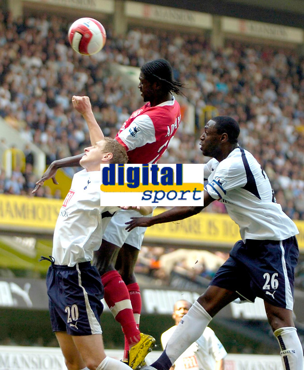 Photo: Ed Godden/Sportsbeat Images.<br /> Tottenham Hotspur v Arsenal. The Barclays Premiership. 21/04/2007. Arsenal's Emmanuel Adebayor heads the ball wide as he is challenged by Michael Dawson and Ledley King.