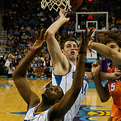 April 8, 2011; New Orleans, LA, USA; Phoenix Suns center Robin Lopez (15), New Orleans Hornets power forward Jason Smith (14) and New Orleans Hornets small forward Patrick Ewing Jr. (22) battle for a rebound during the fourth quarter at the New Orleans Arena. The Hornets defeated the Suns 109-97.   Mandatory Credit: Derick E. Hingle