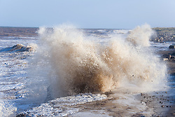Waves pounding the coast and causing erosion at Kilnsea; East Yorkshire; England,