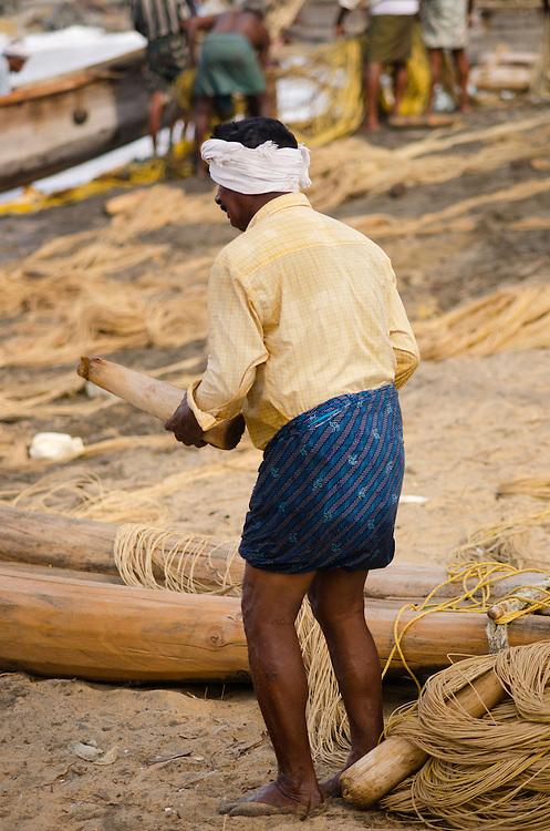 A local fisherman on Varkala beach, Kerala, Indian Subcontinent