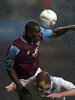 Photo: Olly Greenwood.<br />West Ham United v Brighton & Hove Albion. The FA Cup. 06/01/2007. West Ham's Carlton Cole and Brighton's Joe O'Caeruill