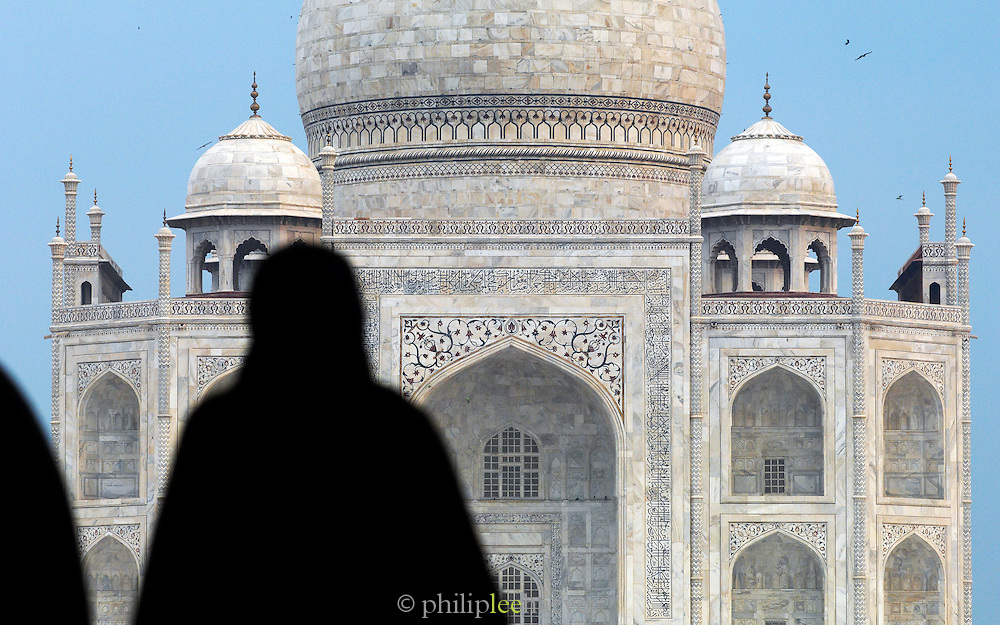 Silouhette of a visitor in front of the Taj Mahal, a UNESCO World Heritage Site, at Agra, India