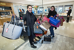 © Licensed to London News Pictures . 26/12/2014 .  Manchester , UK . Two women carrying many handbags in Selfridges in Manchester City Centre for the Boxing Day Sale . Photo credit : Joel Goodman/LNP