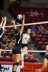 30 August 2011: Tabitha Visk strikes towards Keley Augustine during an NCAA volleyball match between the Cougars of Southern Illinois Edwardsville and the Illinois State Redbirds at Redbird Arena in Normal Illinois.