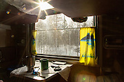 Looking outside from a cabin on the BAM (Baikal-Amur Mainline), Siberia. Russia
