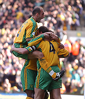 PICTURE BY DANIEL HAMBURY/SPORTSBEAT IMAGES<br />Nationwide Football League Division One    7/3/04<br /><br />NORWICH CITY V IPSWICH TOWN<br /><br />Norwich City's Craig Flemming helps captain and goal scorer Malky Mackay (4) celebrate against Ipswich Town