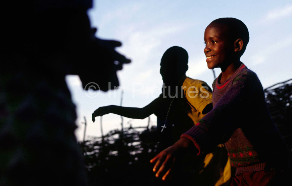 """Orphan children dance for Marguerite Barankitse (known as the 'Angel of Burundi') on one of her visits to Rutimbura, a village largely built by her and her Shalom House orphans. During the genocide, Barankitse, at great personal risk, managed to save 25 orphans, Hutu, Tutsi and Twa and built a home for them. Currently, she has helped more than 10,000 orphans and separated children who can grow up in an """"extended adopted family"""" in security, education and love."""