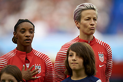 June 28, 2019 - Paris, France - Tobin Heath (Portland Thorns FC) and Megan Rapinoe (Reign FC) of United States during the national anthem beofre the 2019 FIFA Women's World Cup France Quarter Final match between France and USA at Parc des Princes on June 28, 2019 in Paris, France. (Credit Image: © Jose Breton/NurPhoto via ZUMA Press)