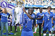 Ngolo Kante of Chelsea holds up the Premier League Trophy. Premier league match, Chelsea v Sunderland at Stamford Bridge in London on Sunday 21st May 2017.<br /> pic by Steffan Bowen,  Andrew Orchard sports photography.