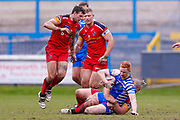 Halifax RLFC winger Conor McGrath (21) is tackled during the Betfred Championship match between Halifax RLFC and London Broncos at the MBi Shay Stadium, Halifax, United Kingdom on 8 April 2018. Picture by Simon Davies.