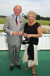 COL PAUL BELCHER and ANDREA DORLER at the Queen's Cup polo final sponsored by Cartier at Guards Polo Club, Smith's Lawn, Windsor Great Park on 18th June 2006.  The Final was between Dubai and the Broncos polo teams with Dubai winning.<br /><br />NON EXCLUSIVE - WORLD RIGHTS