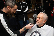 Carmarthen, UK. 7 December, 2019.<br /> Leader of the Labour Party, Jeremy Corbyn has a shave at Big Mel's Barber Shop in Carmarthen, west Wales.<br /> Credit: Gruffydd Thomas