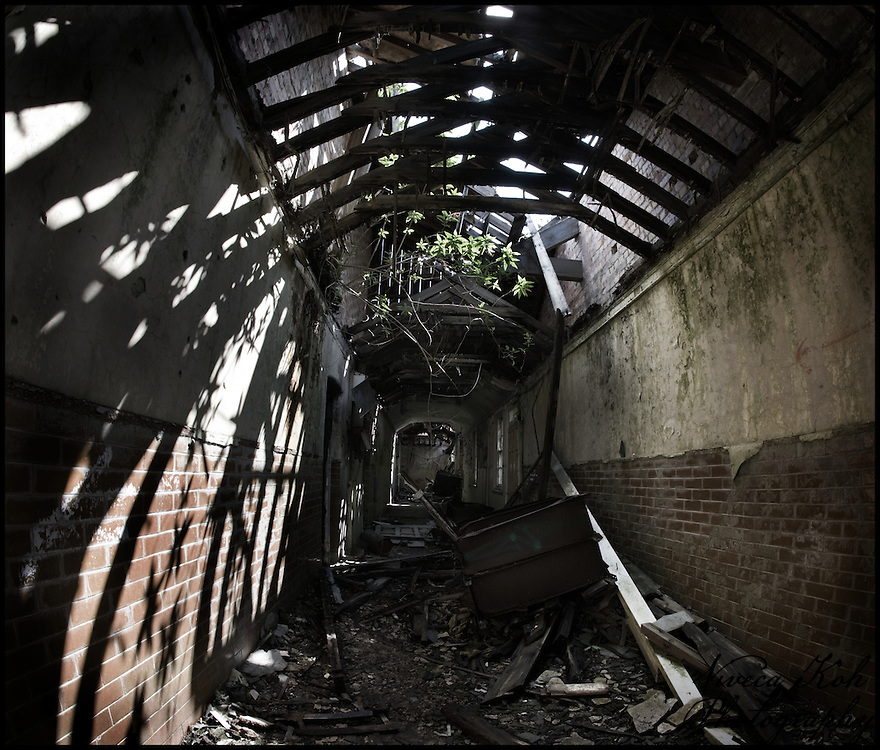 Corridor with sun coming in through damaged roof